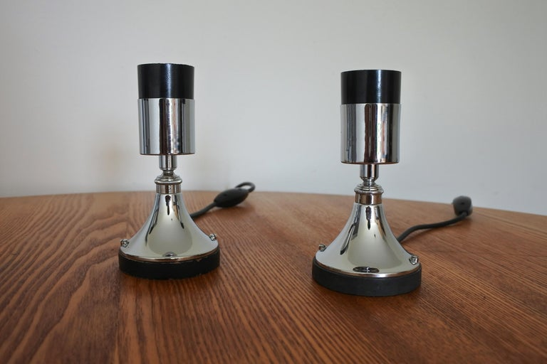 Set of four multi directional table lamps. Made in France in the 1960s. Chromed metal. Original condition with original electrical system. E27 sockets.  A full variety of decorative light bulbs can be used with these lamps. Ideal as ambient