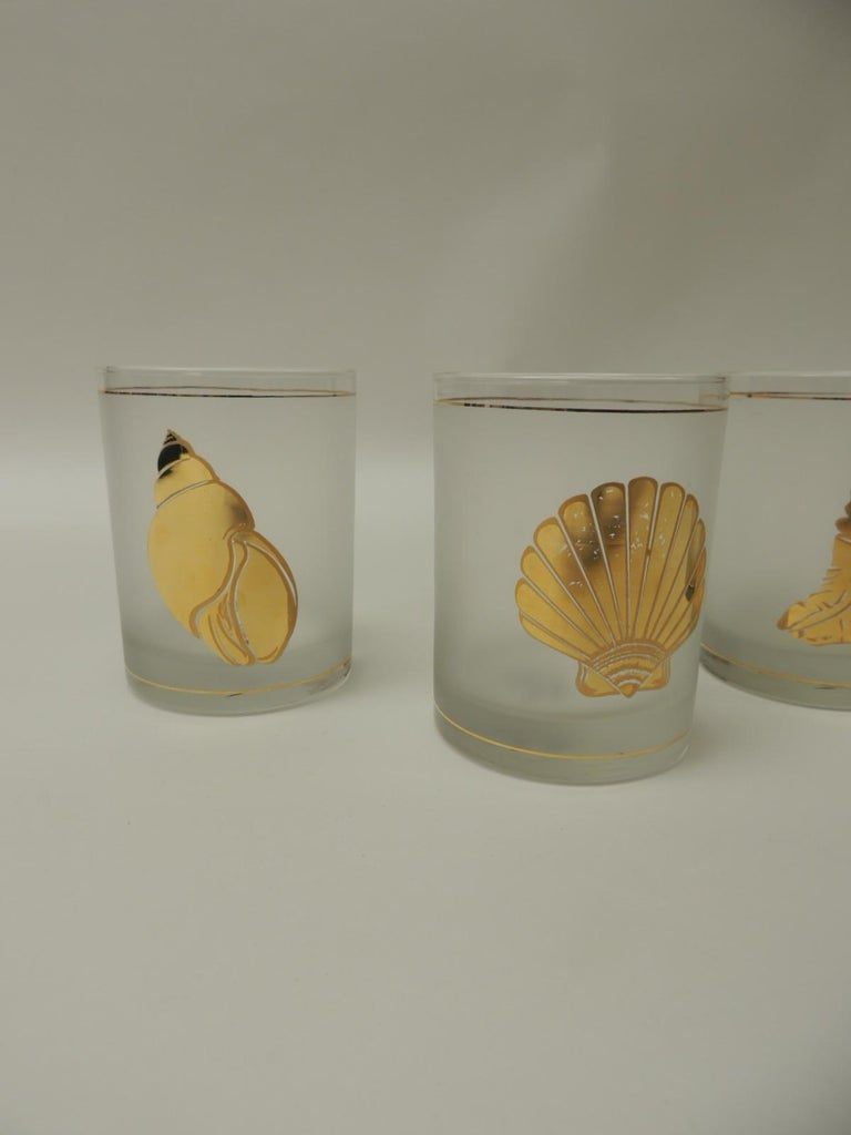 Set of four double old-fashioned frosted glass drinking glasses Gold accent coastal living glasses depicting sea shells. Size: 3 D x 4 H.