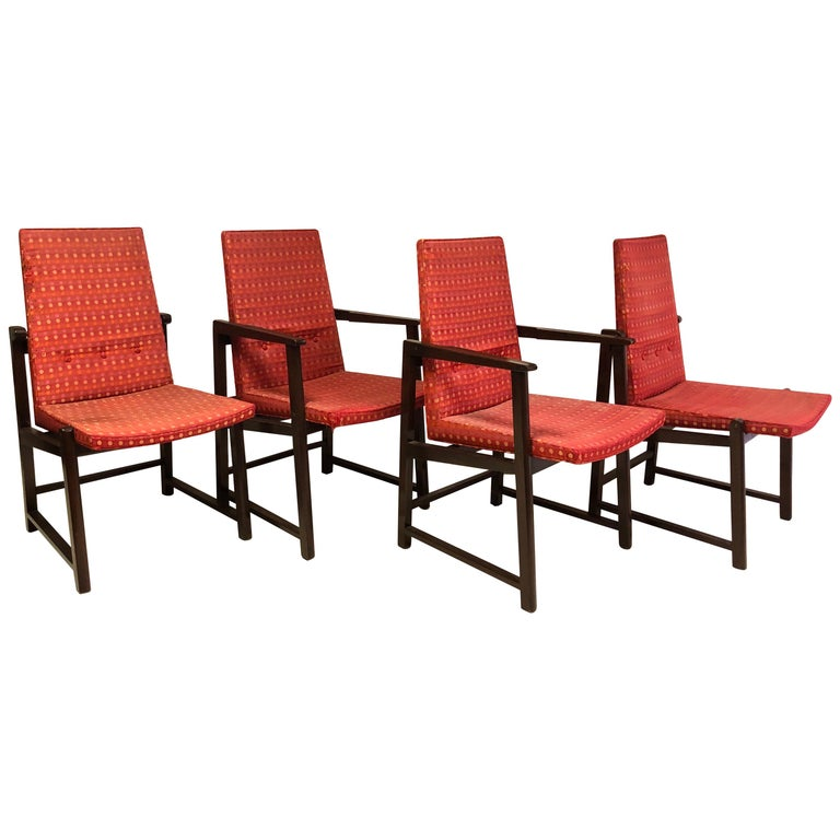 Edward Wormley for Dunbar dining chairs, models 6038 & 6037 in dark mahogany frames with original Jack Lenor Larsen fabric. Two arm and two side chairs, supported by brass spacers, with Dunbar label.