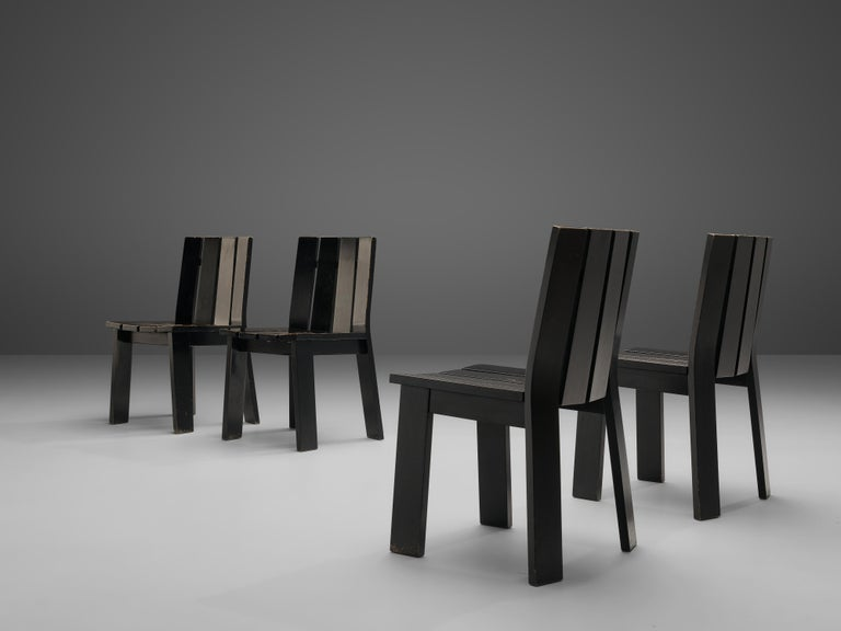 Dining chairs, black lacquered wood, the Netherlands, 1970s  These four dining chairs show a great well-balanced design with thin wood slats. The all-black design gives the chairs a certain grandeur. Four slats form the seat and back. The two outer