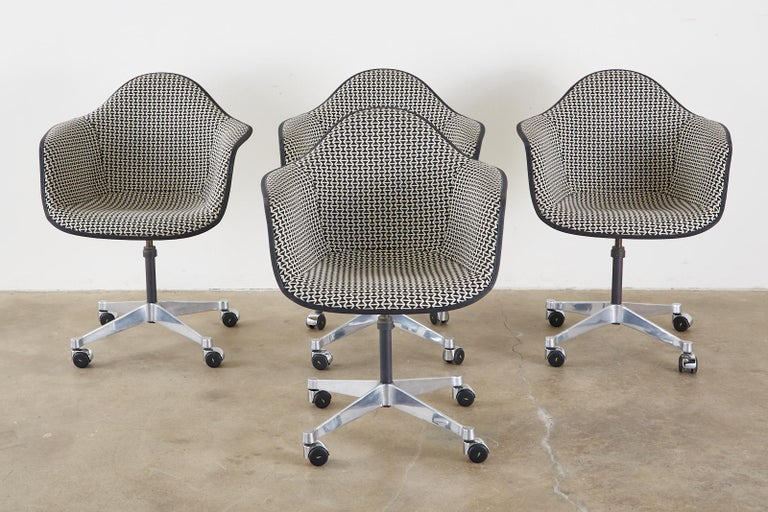 Polished Set of Four Eames for Herman Miller Swivel Shell Chairs  For Sale