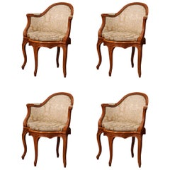 Set of Four Early 20th Century French Louis XV Carved Walnut Armchairs