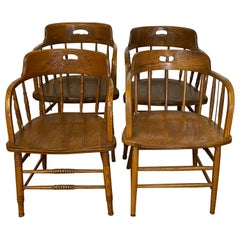 Set of Four Early 20th Century Mismatched Barrel Back Oak Pub Chairs