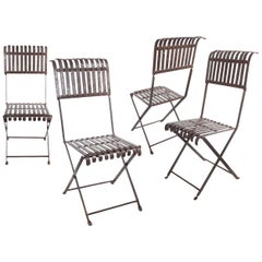 Set of Four Early Handmade Iron Chairs