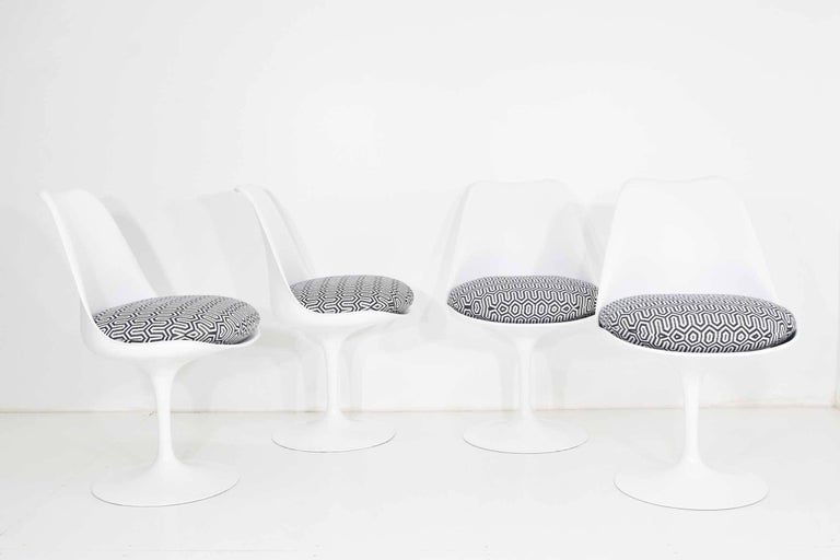Chairs have new cushions in a Donghia black and white geometric fabric. Chairs do not swivel.