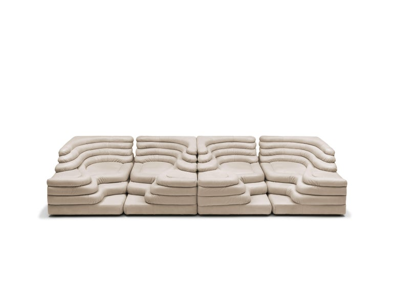 DS-1025 sofa composition by Ublad Klug for De Sede of Switzerland  The sofa system is composed by four elements (two left and two right elements) that can be combined together to achieve different configurations.   Solid construction in plywood,