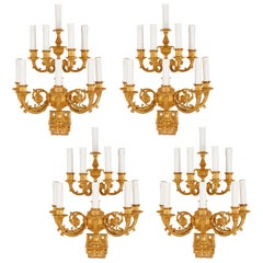 Set of Four Empire Style Ten-Branch Gilt Bronze Sconces