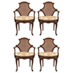 Set of Four English 19th Century Dark Oak Cane Armchairs