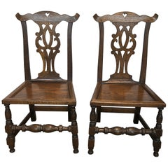 Set of Four English Bench-Made Chippendale Plank Seat Elm Chairs