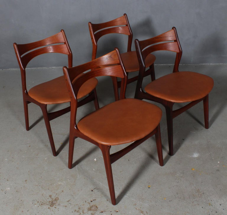Four Eric Buch chairs with frame of partly solid teak.  New upholstered with tan aniline leather.   Model 310, made by Chr Christensens Møbelfabrik, Denmark.