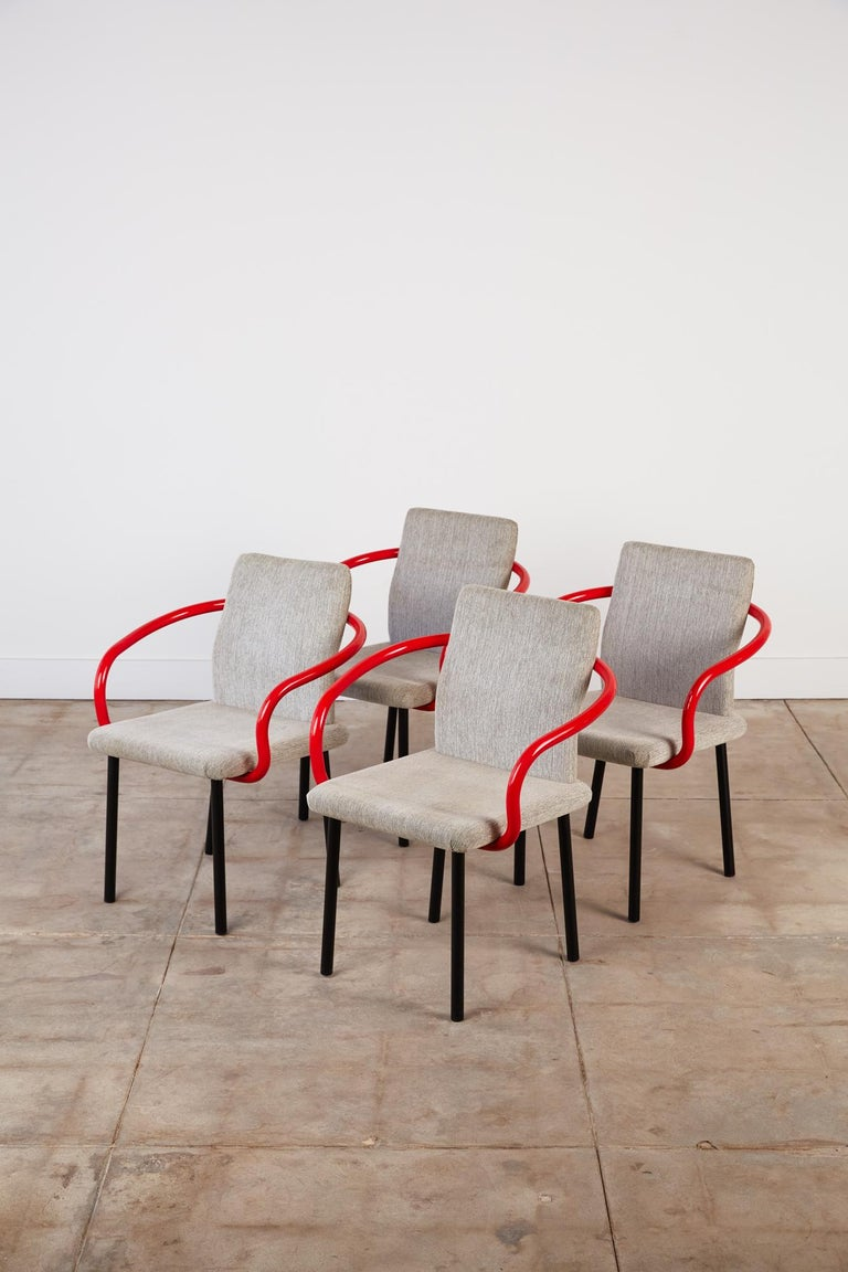 A 1986 design by Ettore Sottsass for Knoll, the Mandarin chair has a curved back- and armrest, upholstered seat, and four round legs in enameled metal. A slight wave in the backrest gives it an ergonomic swell. The chair plays equally to Sottsass'
