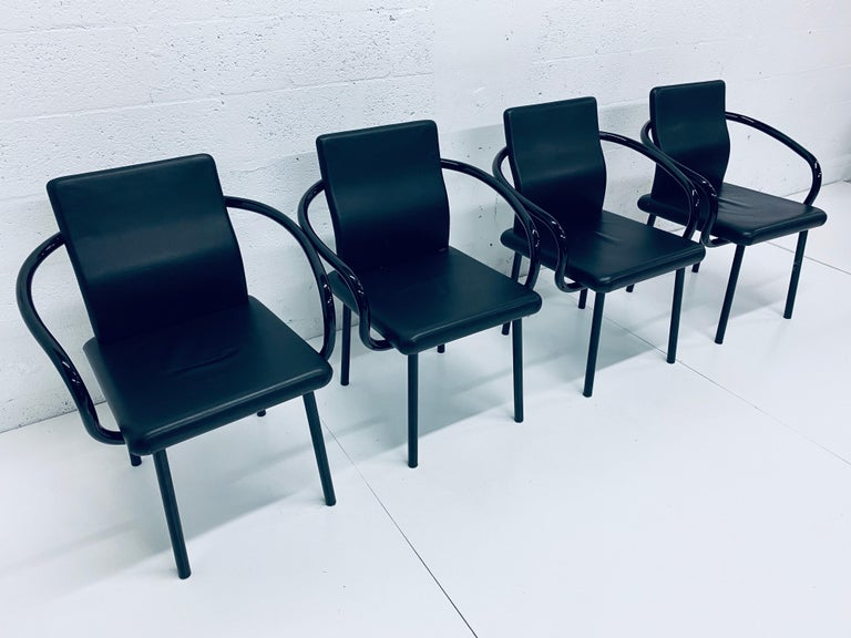 Memphis Postmodern Mandarin chairs rendered in black lacquered steel frame with black Naugahyde cushioned seats designed by Ettore Sottsass for Knoll.