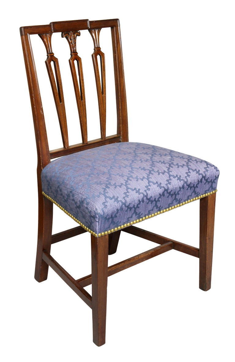 Each with a square paneled crest rail over three pierced stick splats, nicely upholstered seat raised on tapered square legs and H form stretcher.