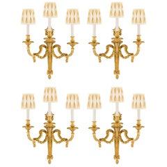 Set of Four French 19th Century Louis XVI St. Three-Light Ormolu Sconces