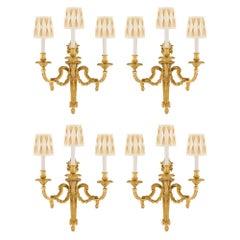 Set of Four French 19th Century Louis XVI Style Three-Light Ormolu Sconces