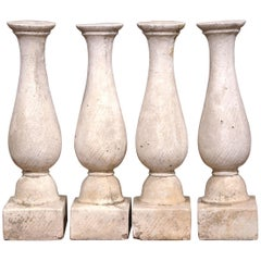 Set of Four French 19th Century Patinated Carved Stone Balusters