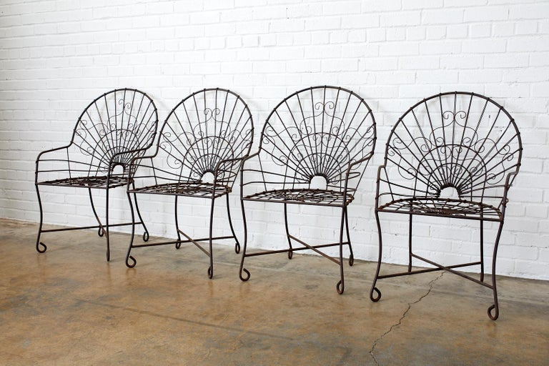 Hand-Crafted Set of Four French Art Nouveau Iron Garden Chairs For Sale