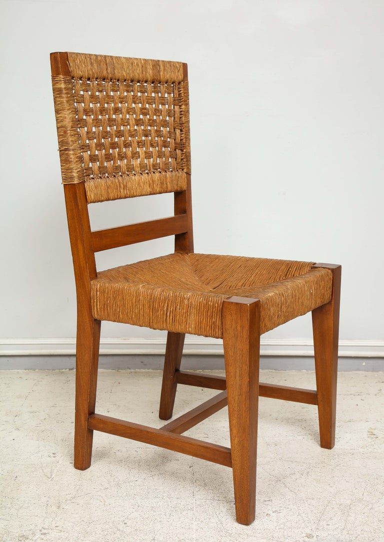 Set of four French caned chairs from circa 1940s-1950s.