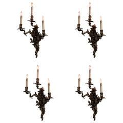 Set of Four French Gilt Bronze Three Light Sconces, Louis XV Style
