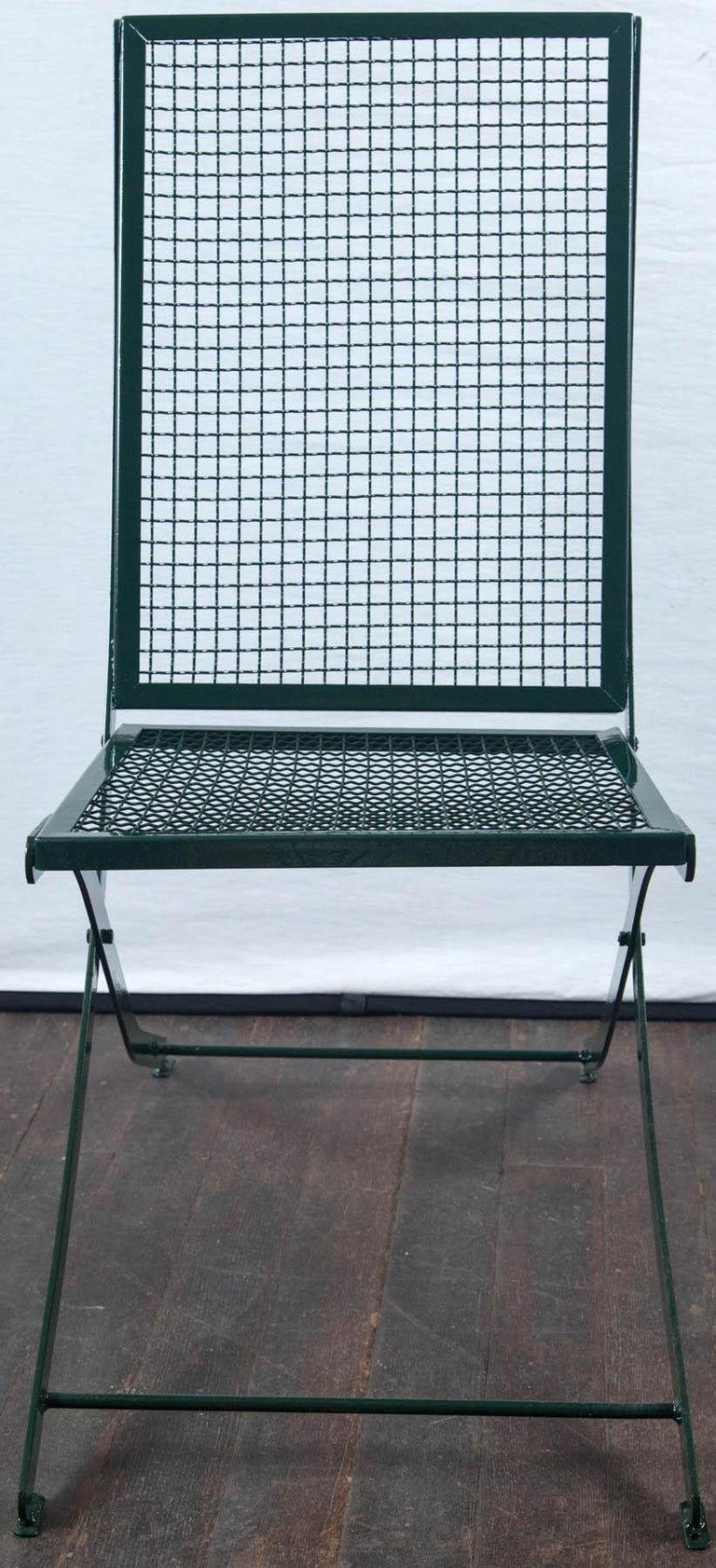 Set of four old French garden chairs from Paris with a new professional dark green finish.