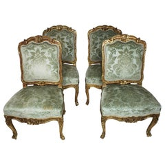 Set of Four French Louis XV Rococo Style Giltwood Carved Side Chairs