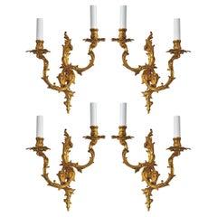 Set of Four French Louis XVI Style Gilt Bronze Electrified Two-Light Sconces