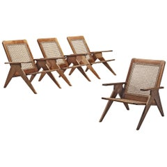 Set of Four French Lounge Chairs in Cane and Mahogany