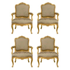 Set of Four French Mid-19th Century Louis XV Style Giltwood Armchairs
