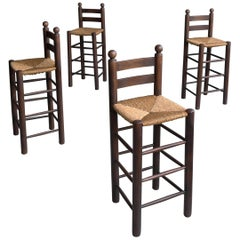 Set of Four French Oak Barstools with Rush Seats in Style of Charles Dudouyt
