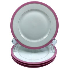 Set of Four French Pink and Gilt Banded Plates