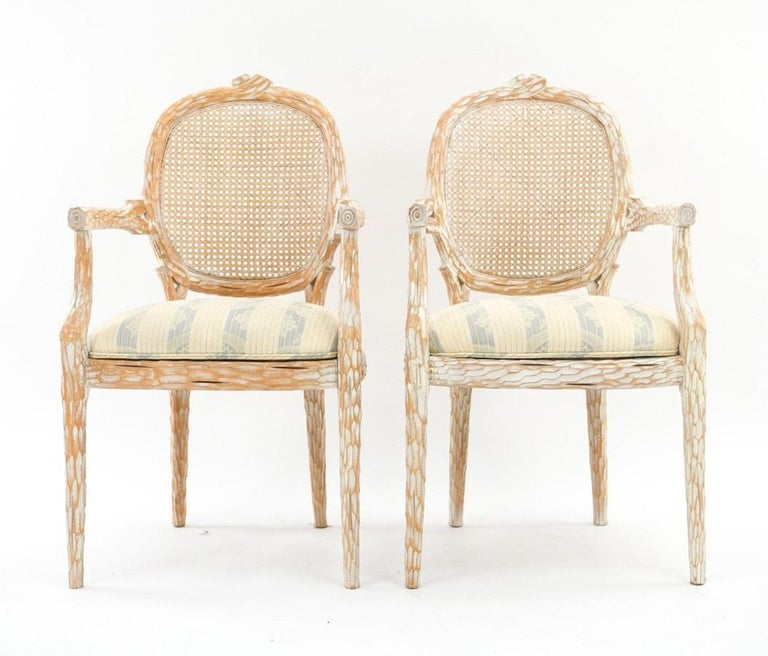 Set of four French style Cerused balloon back dining chairs. The chairs have caned backs and fabric covered seats.