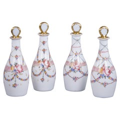 Set of Four French White Opaque Decanters and Stoppers, circa 1830
