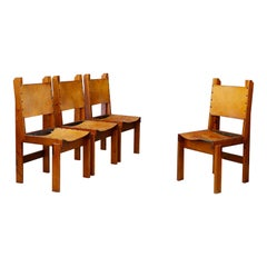 Set of Four French Wood and Leather Chairs in the Style of Pierre Chapo, 1960s