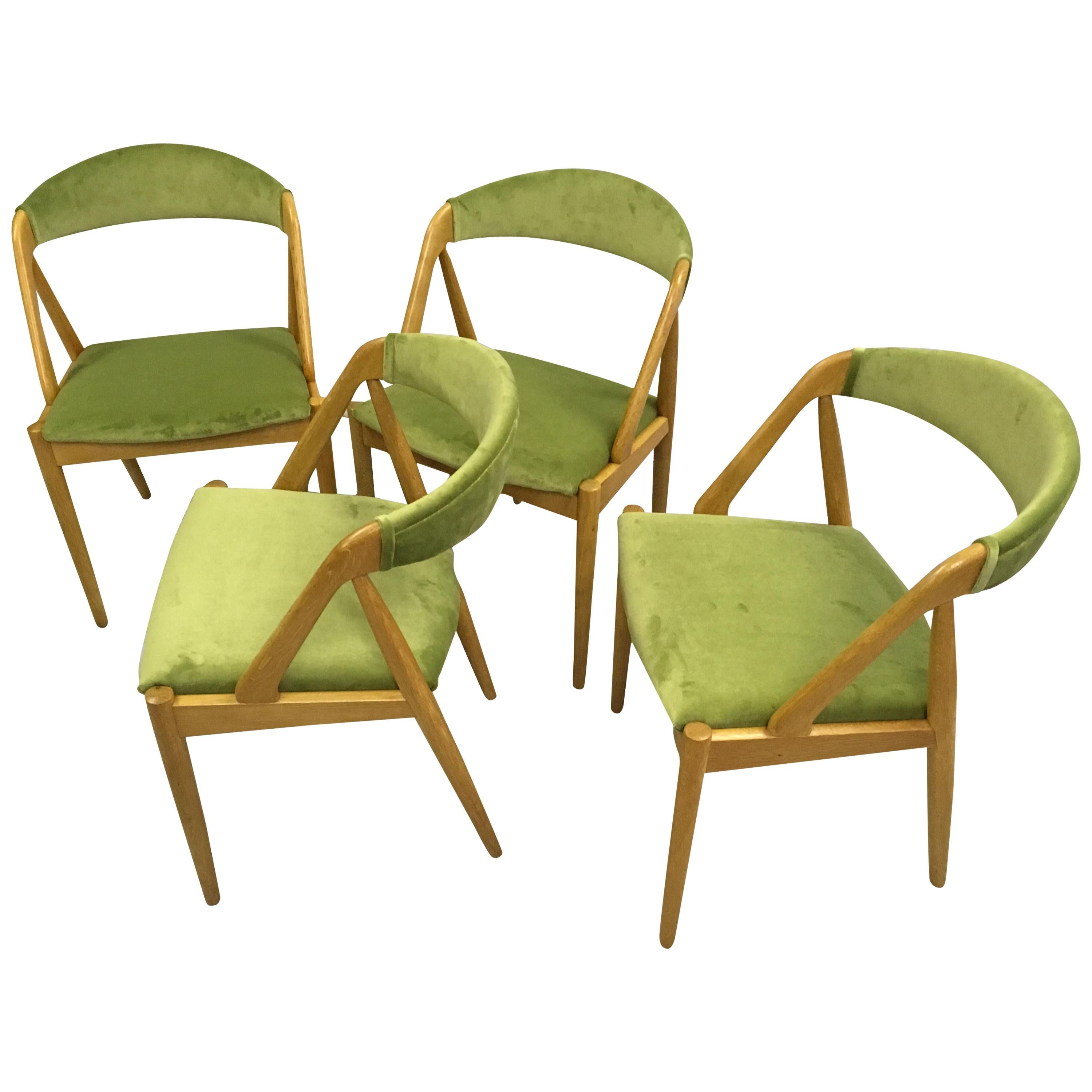 Set of Four Fully Restored Kai Kristiansen Oak Dining Chairs, Inc. Reupholstery