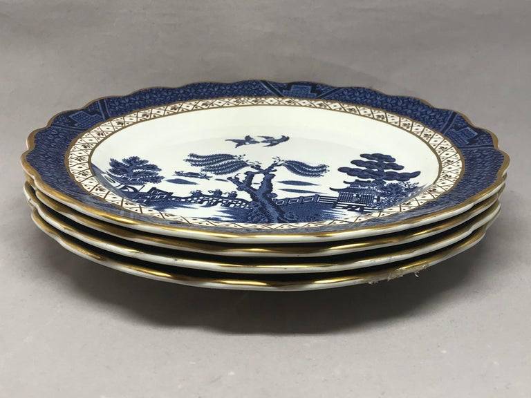 Set of four gilded blue and white chinoiserie dessert plates. Set of four English
