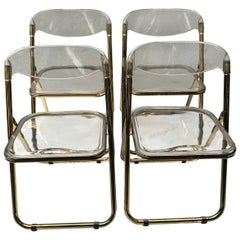 Set of Four Gold Plia Folding Lucite Chairs in the Style of Giancarlo Piretti