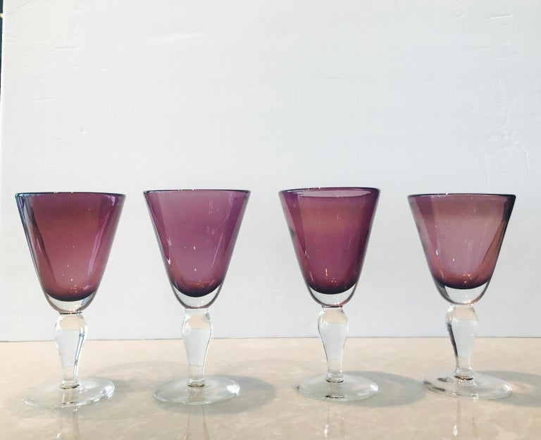 Set of four vintage wine or water goblets in blown Murano glass. Glasses have clear glass stems with gorgeous amethyst colored cased glass goblets. Each varies slightly as they are unique and individually hand blown.