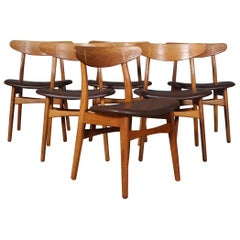 Set of Four Hans J. Wegner Dining Chairs Model CH-30 in Oak