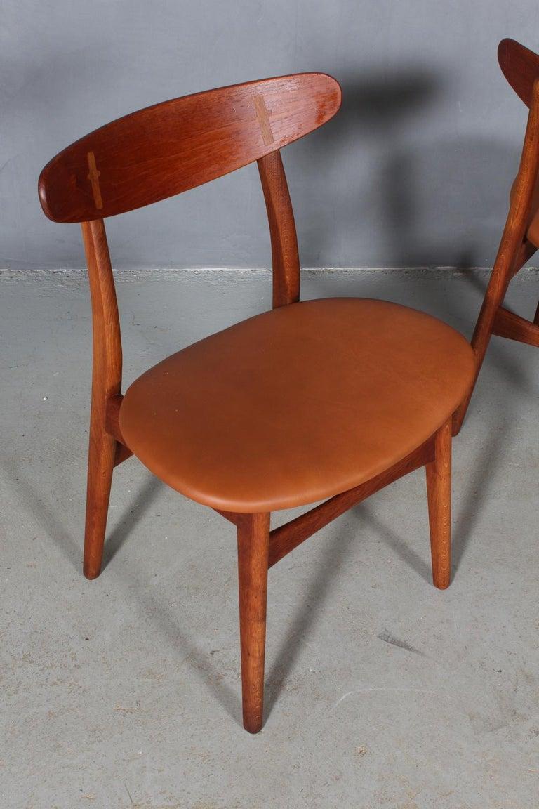 Scandinavian Modern Set of Four Hans J. Wegner Dining Chairs Model CH-30 in Teak and Oak For Sale