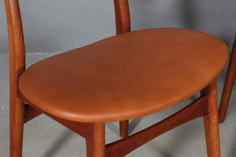 Mid-20th Century Set of Four Hans J. Wegner Dining Chairs Model CH-30 in Teak and Oak For Sale