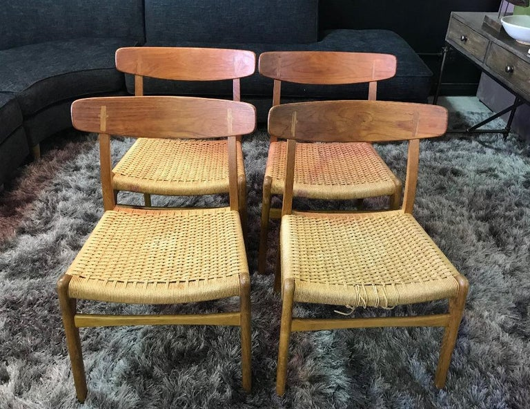 Iconic in design and aesthetic. First introduced in 1950 by famed Danish designer Hans Wegner, these CH23 chairs features refined styling and masterful craftsmanship and are immediately recognizable with their curved seat backs and