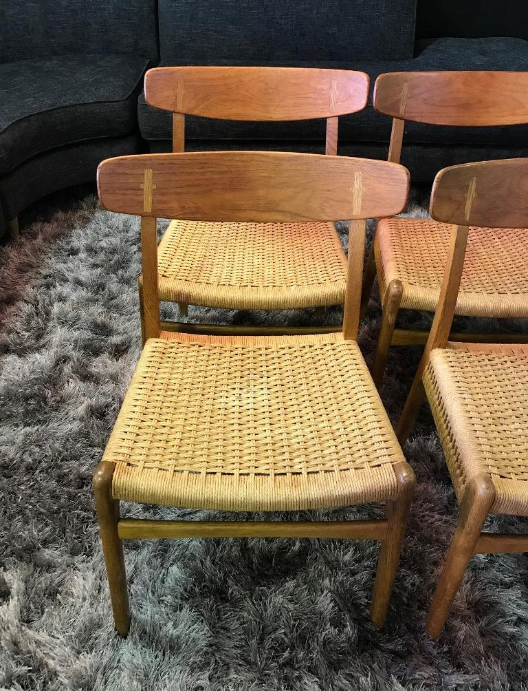Hand-Woven Hans Wegner Set of Four Mid-Century Modern Classic CH23 Dining Chairs For Sale