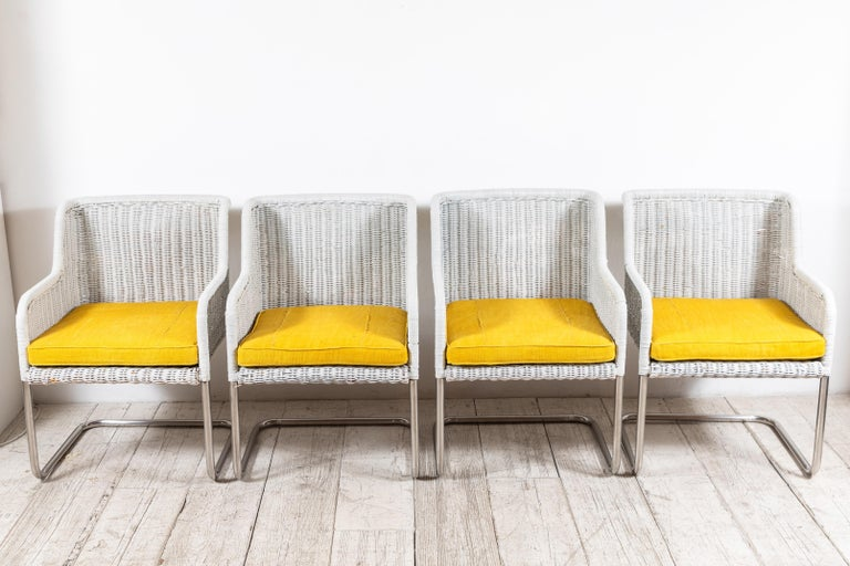 Set of four Harvey Probber style white painted wicker chairs with newly upholstered yellow mud-cloth seat cushions.