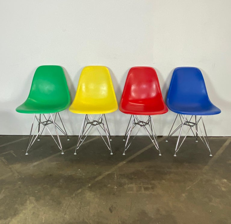 Gorgeous set of 4 Herman Miller Eames dining chairs. Vintage fiberglass shells are stamped Herman Miller and guaranteed authentic. Surfaces has been custom recoated in vibrant colors (which were not originally offered) and clear coated. On new
