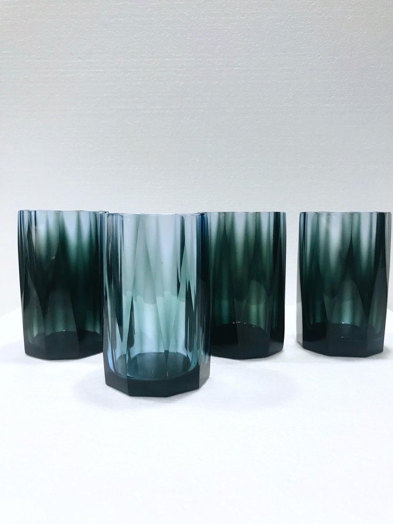 Vintage hand blown water glasses or double old fashioned barware glasses with faceted prism design. Each glass is individually handcrafted, creating a unique blend of colors in gradient smoked blue and gray. Hollywood Regency design making a chic