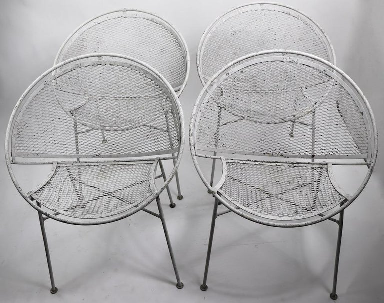 Set of four Hoop, or Radar chairs designed by Maurizio Tempestini for Salterini. All four are in very good original condition, showing only cosmetic wear to the finish, normal and consistent with age. The chairs are dining height ( Seat H 17 inch )