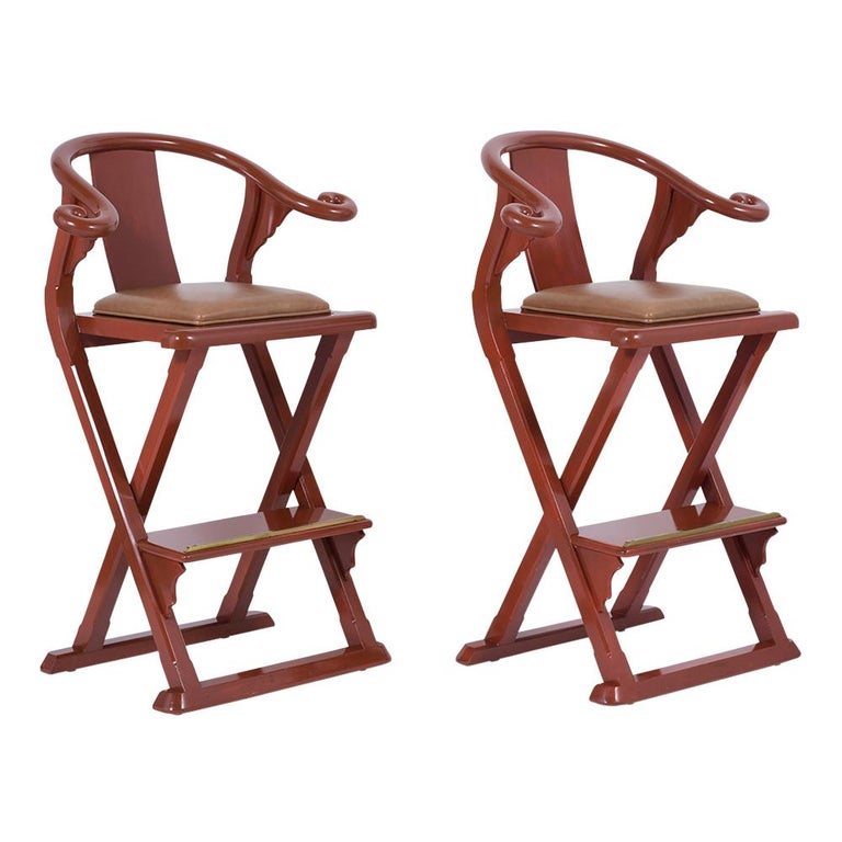 This set of four curved barrel back stools are made out of maple wood with uniquely handcrafted frames and have been restored. The frames are painted in oxblood red color with lacquer finish the seat cushions are newly upholstered in leather. This