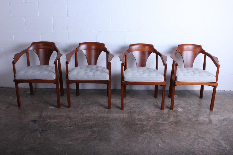 A set of four horseshoe armchairs designed by Edward Wormley for Dunbar.