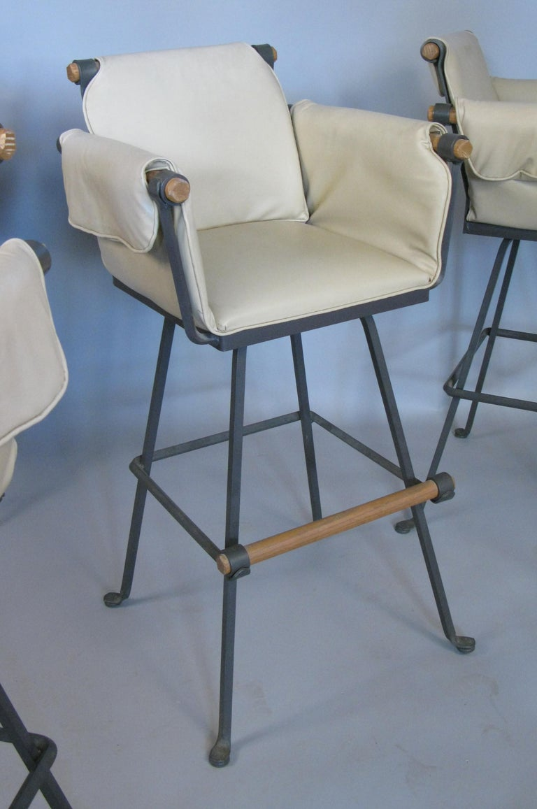 American Set of Four Iron and Oak Swivel Barstools by Cleo Baldon For Sale