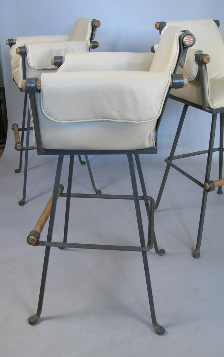 Late 20th Century Set of Four Iron and Oak Swivel Barstools by Cleo Baldon For Sale